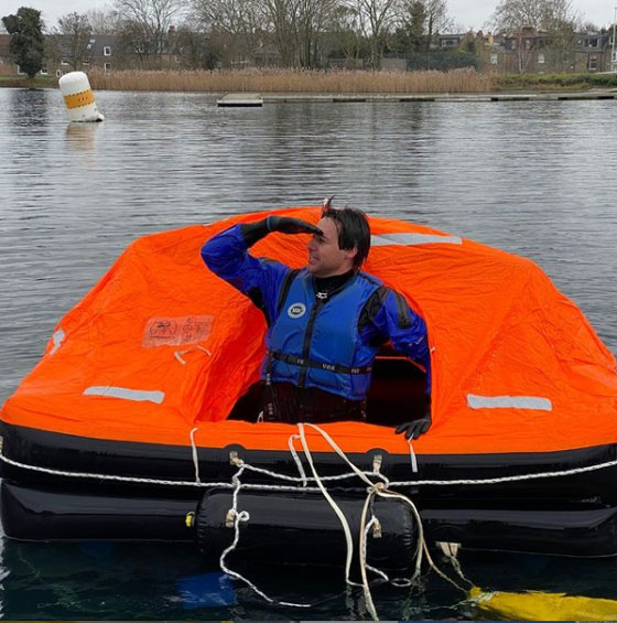 Photo of Ben floating in a raft during training